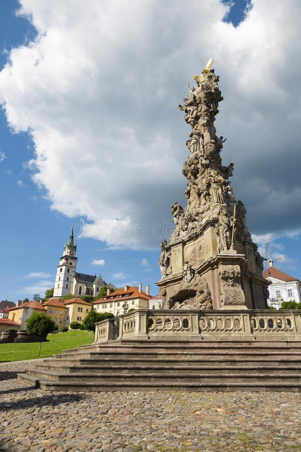 Kremnica - The Safarikovo square the baroque Holy Trinity column by Dionyz Ignac Stanetti 1765 - 1772 , castle and St. Catherine c royalty free stock photos
