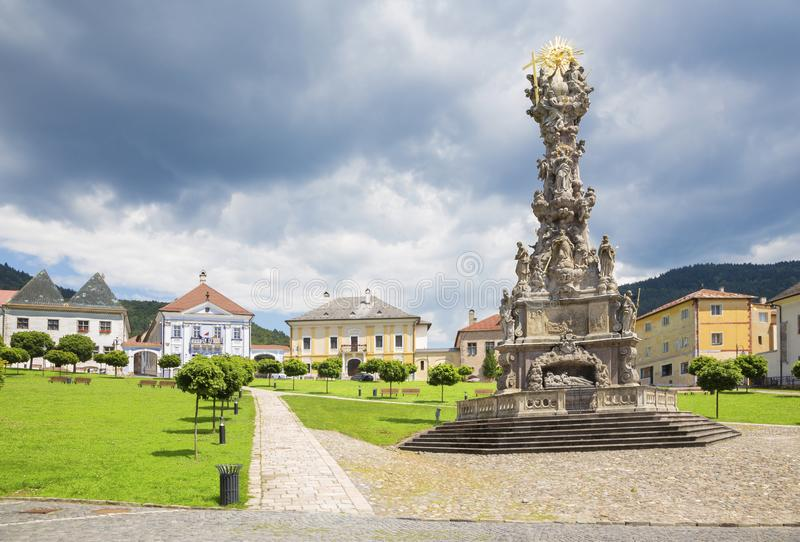 Kremnica  - The Safarikovo square the baroque Holy Trinity column by Dionyz Ignac Stanetti 1765 - 1772 , castle and St. royalty free stock image