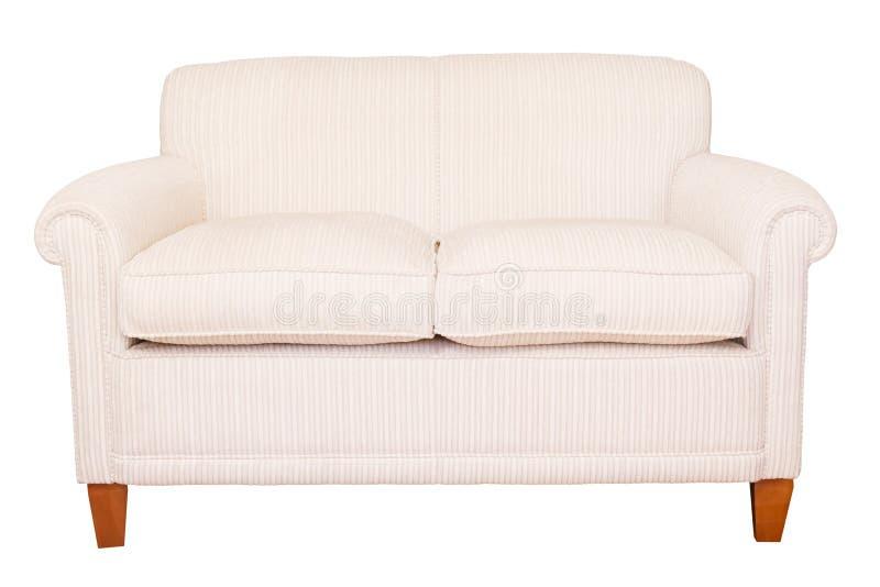 Kremowy kanapy biel tło obrazy stock