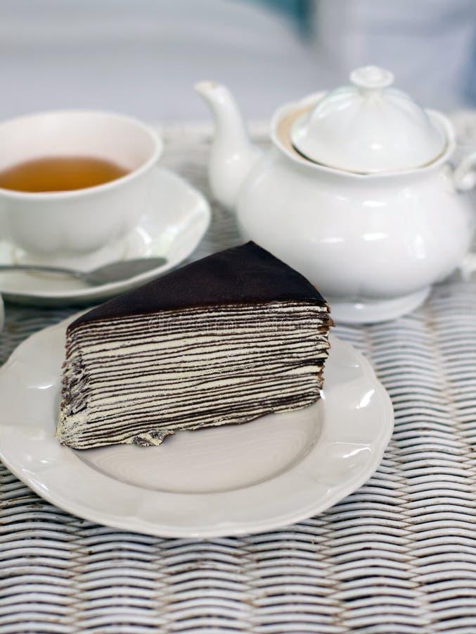 Kreppkuchen mit dajeeling Tee stockfotos