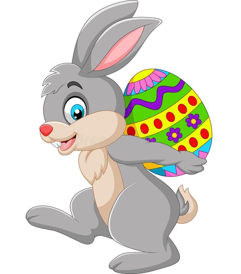 Kreskówka królik niesie Wielkanocnego jajko royalty ilustracja