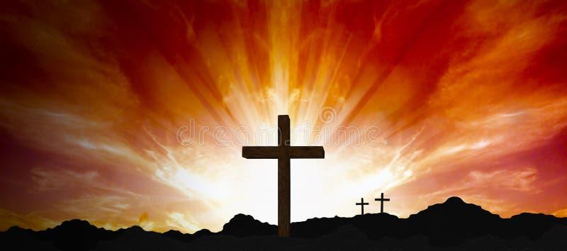 Kreuz gegen roten Himmel stockfoto