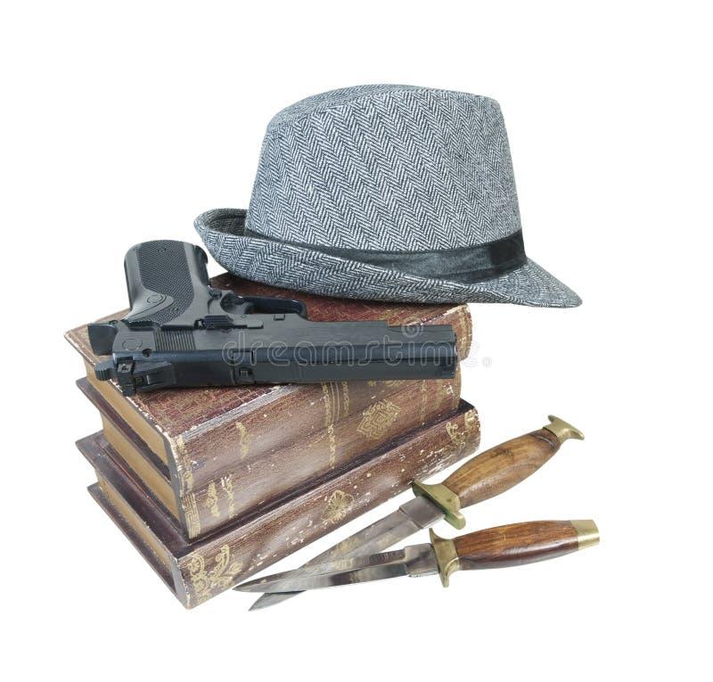 Krimi bucht Gewehr-Messer-Hut stockfotos