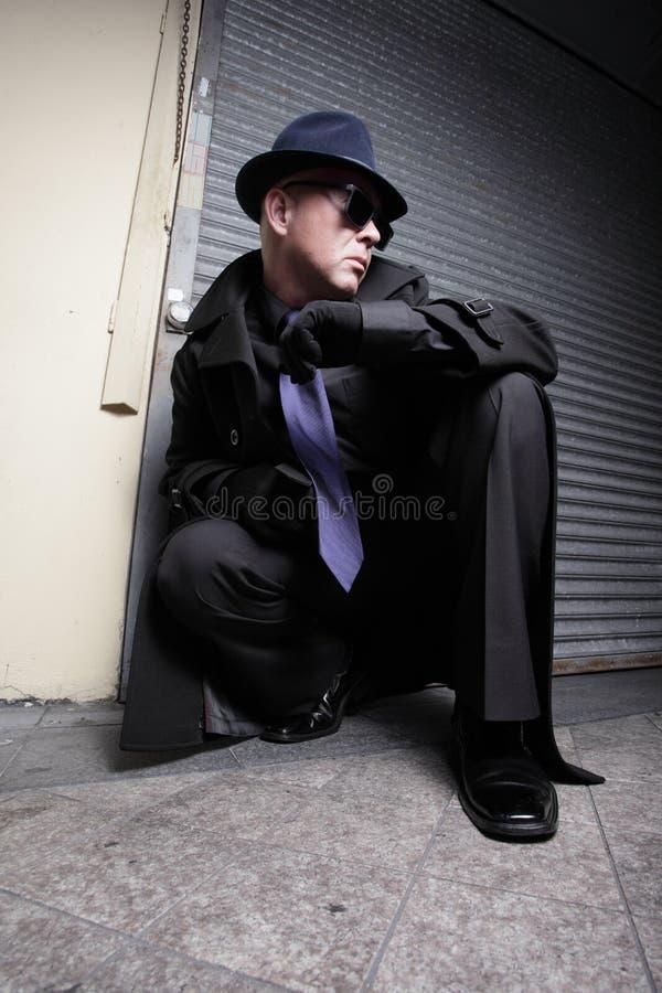 Kriminelles Lauern stockfotos