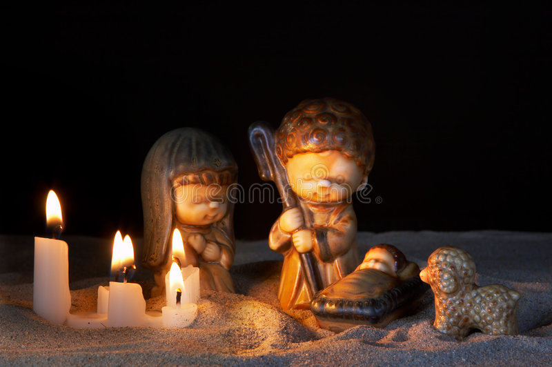 Krippe und Kerzen stockfotografie