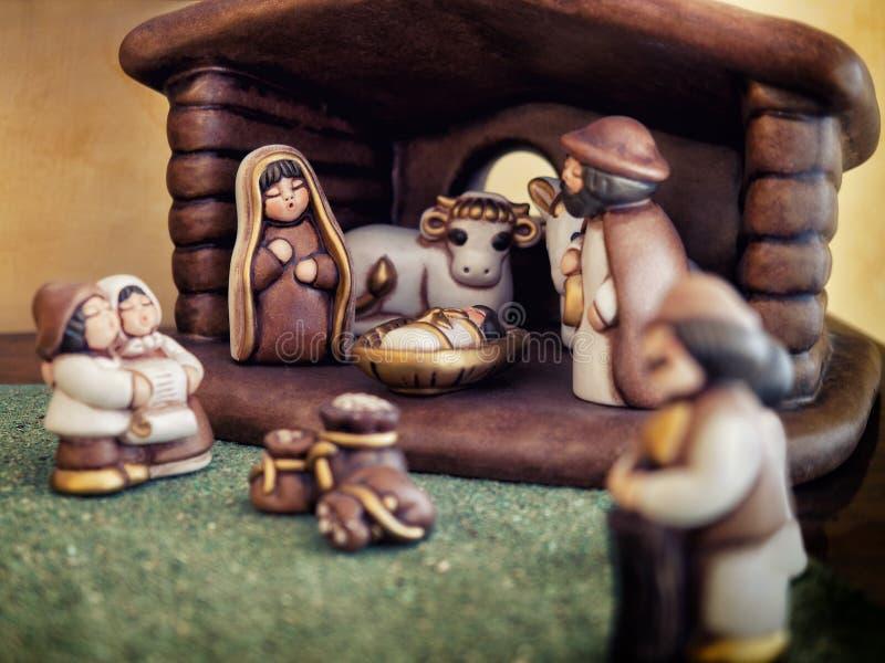 Krippenfigürchen-Weihnachtsreligiöse Tradition stockbild