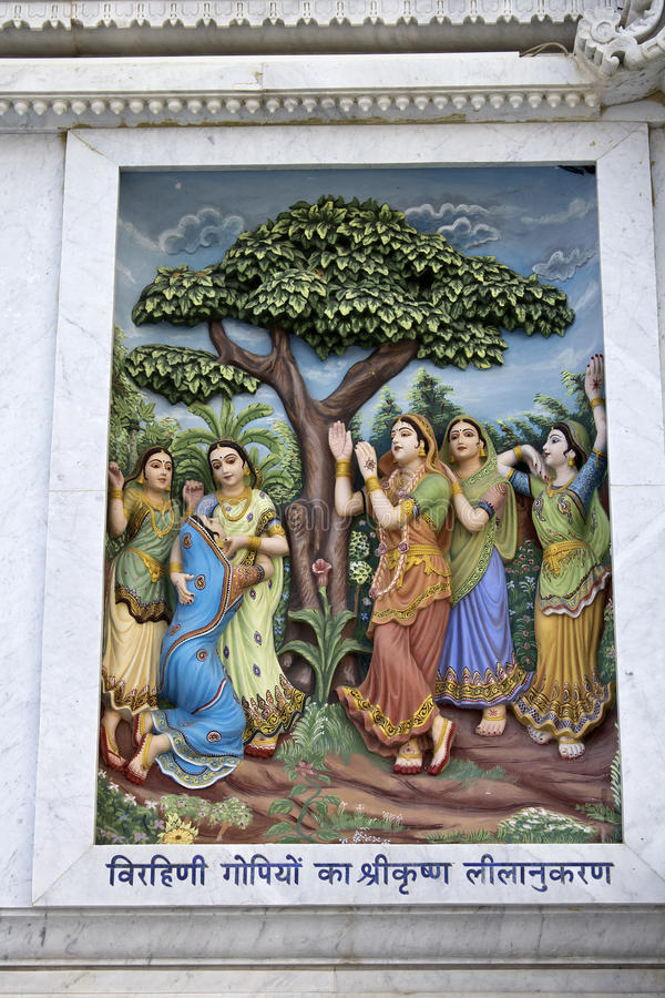 Krishna-lila. MARCH 2, 2014, VRINDAVAN, UTTAR-PRADESH, INDIA - Image describes the hily pastimes of Lord Krishna or Krishna-lila on the wall of Prem Mandir or royalty free stock photo