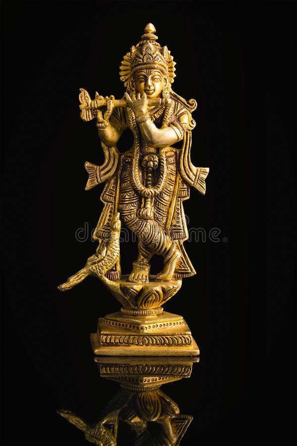 krishna statue white krishna god vishnu avatar brass statue isolated black reflection 130273022