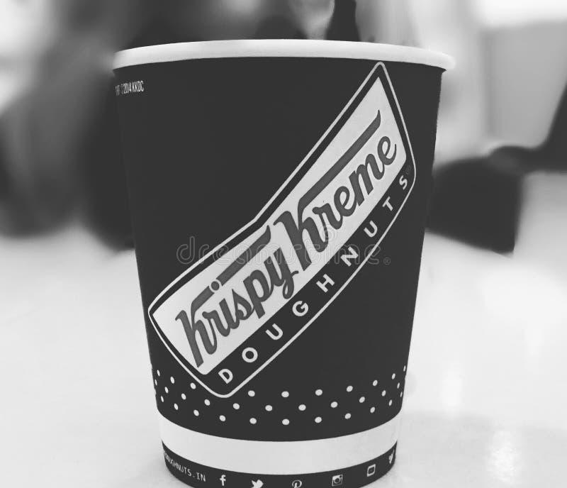 Krispy Kreme Doughnuts cup of coffee stock photography