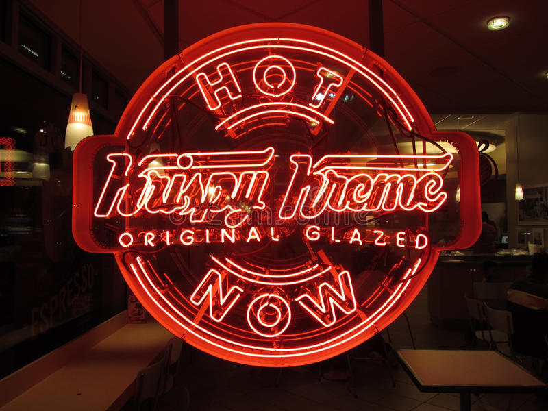 Krispy Kreme Logo. Photo of krispy kreme electric sign at night on 12/15/12. This fast food eatery is an american icon