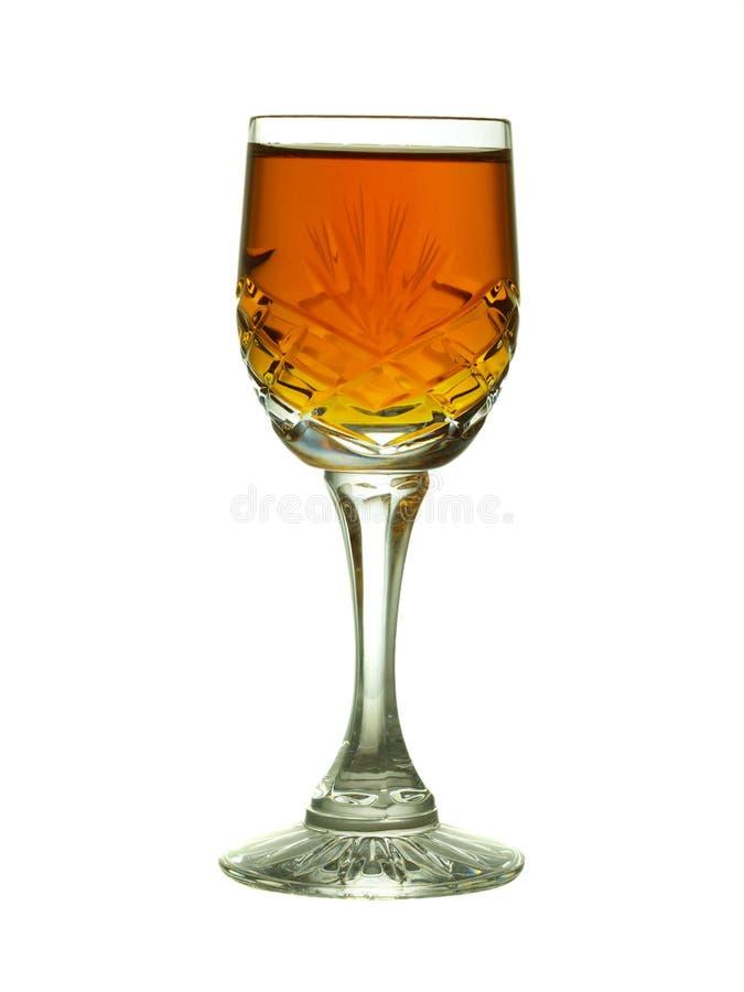 Kristallglas mit dem Sherry - backlit lizenzfreie stockfotos