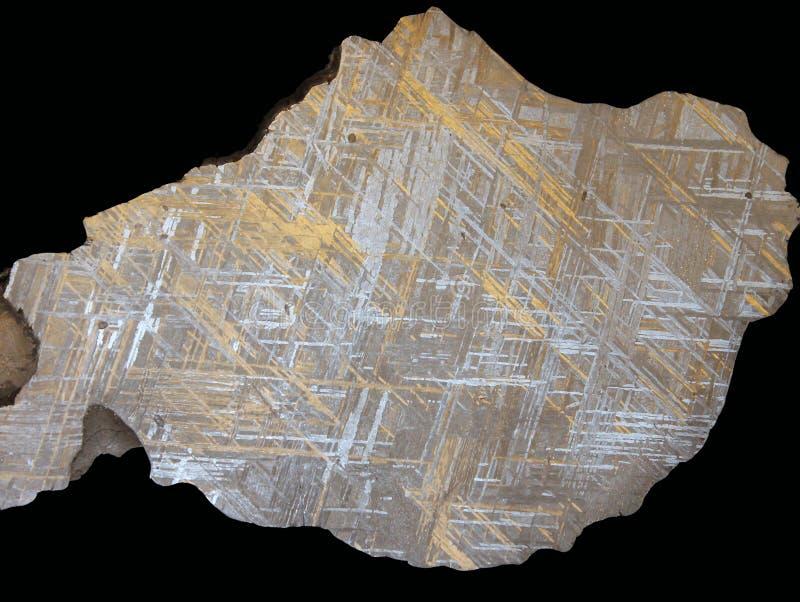 Kristalliserat utomjordiskt järn - meteoritWidmanstätten modell royaltyfri bild