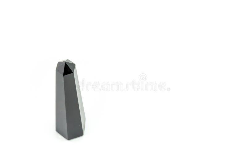 Kristallstab des schwarzen Obsidians auf weißem Hintergrund stockbilder
