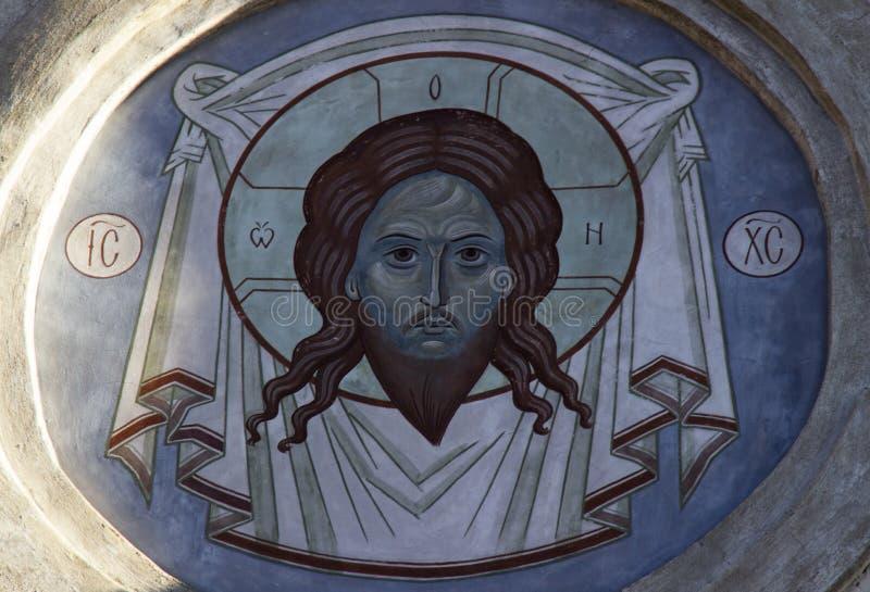 Kristen freskomålning på fasaden av kyrkan royaltyfria bilder