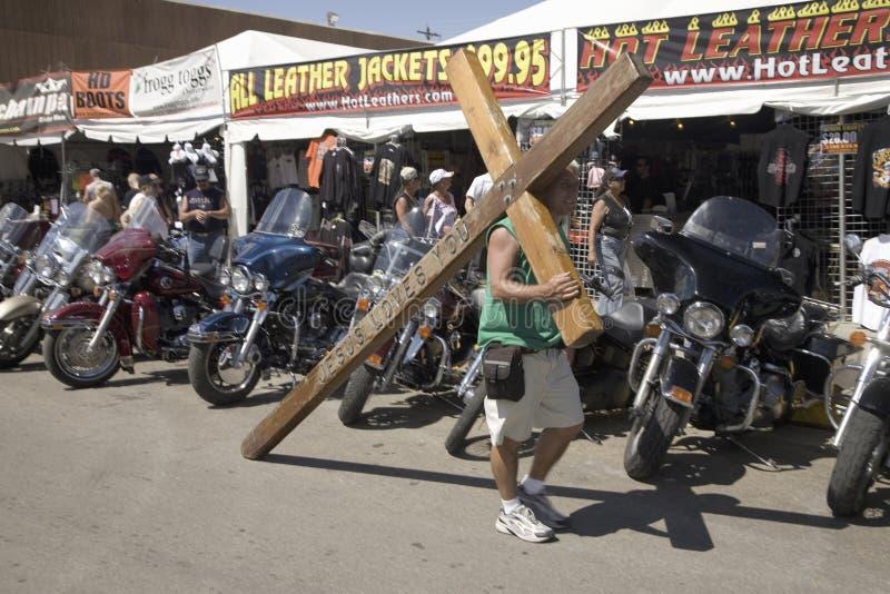 Kristet bära som är argt för Jesus arkivfoto
