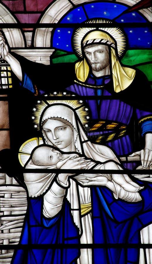 Kristi födelsen: födelsen av Jesus Christ i målat glass arkivfoto