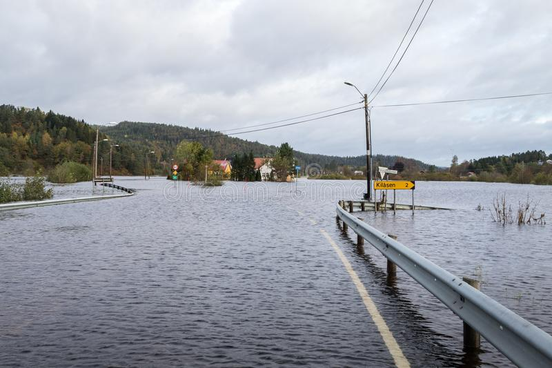 Kristiansand, Norway - October 3, 2017: Flooding from the river Tovdalselva in Kristiansand, Norway. Water floods the. Water flooding the road - October 3, 2017 royalty free stock images