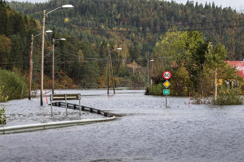 Kristiansand, Norway - October 3, 2017: Flooding from the river Tovdalselva in Kristiansand, Norway. Water floods the. Water flooding the road - October 3, 2017 stock photo