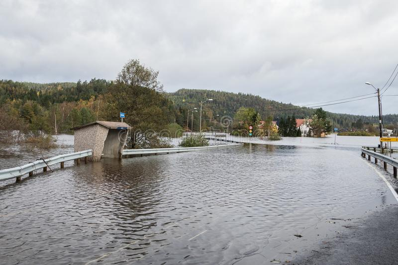 Kristiansand, Norway - October 3, 2017: Flooding from the river Tovdalselva in Kristiansand, Norway. Water floods the. Water flooding the road - October 3, 2017 stock images