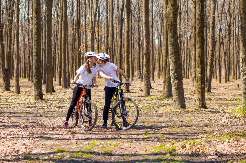Krivoy Rog, Ukraine - April 9, 2019: Happy couple riding bicycles outside, healthy lifestyle fun concept. exercise togethe. Krivoy Rog, Ukraine - April 9, 2019 stock photo