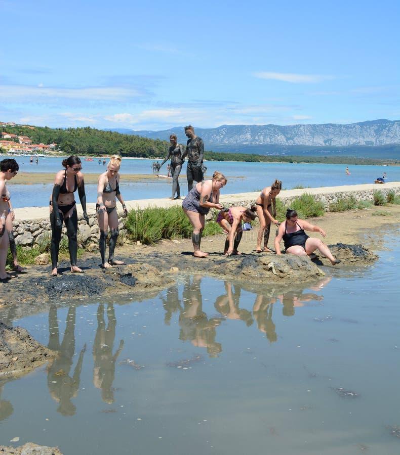 KRK, CROATIA -JULY 02, 2014:Healthy mud beach in Cizici Soline on Krk island, Kvarner bay of Croatia royalty free stock photos