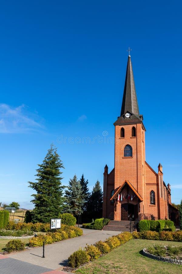 Krojanty, pomorskie / Poland - September, 4, 2019: Brick Catholic church in a small village. Brick temple in Central Europe stock photos