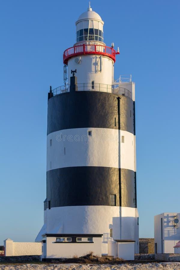 Krokfyren på den sydliga kusten av Irland är det äldsta fungerande i världen royaltyfri bild