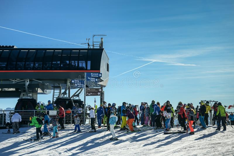 People enjoy skiing at Kronplatz Plan de Corones ski resort in the snowy Dolomites royalty free stock photography