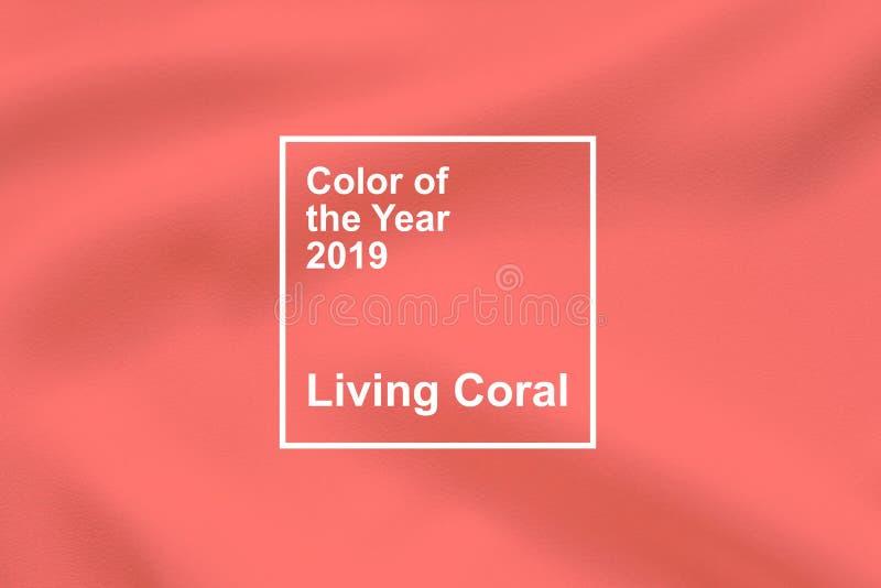 """KROPIVNITSKIY UKRAINA †""""06 December, 2018: Bo korall, Pantone färg av bakgrunden 2019 för årstygtextil strömförande royaltyfria bilder"""