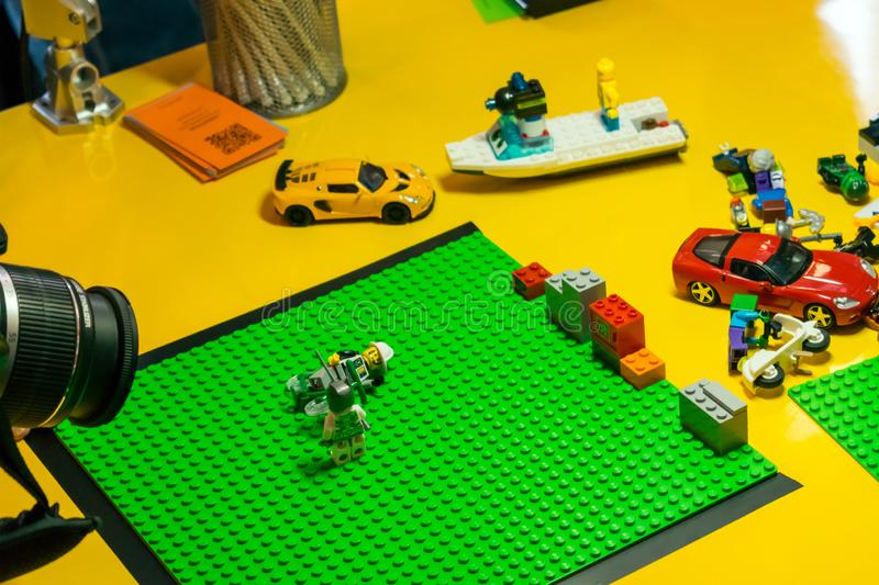 KROPIVNITSKIY, UKRAINE – 12 MAY, 2018: Stop motion animation p. Rocess with Lego details and toy cars. Сreating video clip, expose stop motion elements royalty free stock images