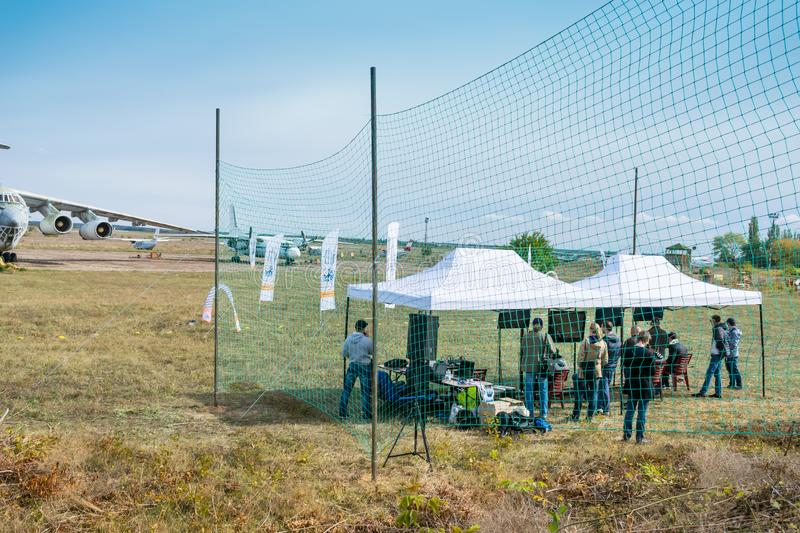 KROPIVNITSKIY, UKRAINE – 07 OCTOBER, 2017: Drone racing among. Airplanes on the territory of the airfield. Drone racing track with gates and flags on stock image