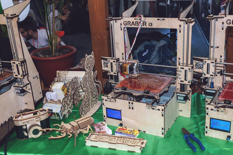KROPIVNITSKIY, UKRAINE 12 MAY, 2018: Plywood 3D printer graber i3. Wooden Three dimensional printing machine and various 3D. KROPIVNITSKIY, UKRAINE stock images