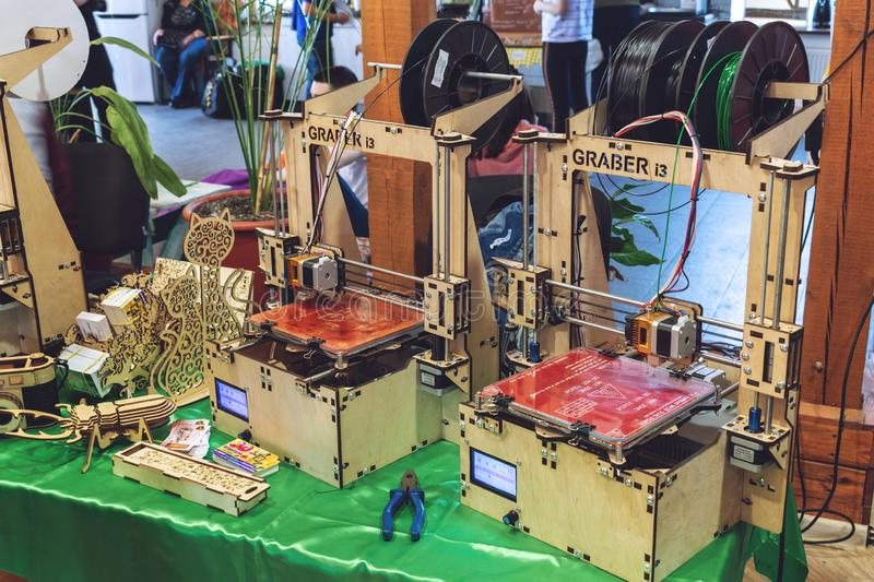 KROPIVNITSKIY, UKRAINE 12 MAY, 2018: Plywood 3D printer graber i3. Wooden Three dimensional printing machine and various 3D. KROPIVNITSKIY, UKRAINE royalty free stock images