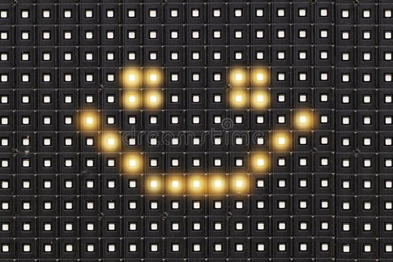 Kropki matryca prowadził diplay z iluminującym symbolem uśmiech twarz zdjęcia stock