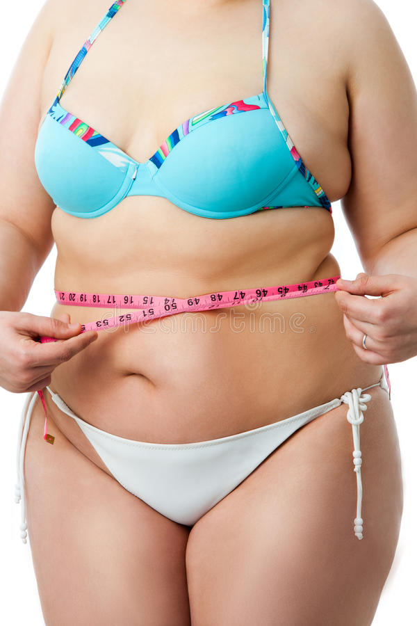 Kroppdetalj av den överviktiga flickan i bikini royaltyfria bilder