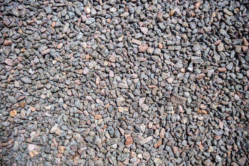 Krossat grus som bakgrund eller textur, bakgrund av granitgrus royaltyfria bilder