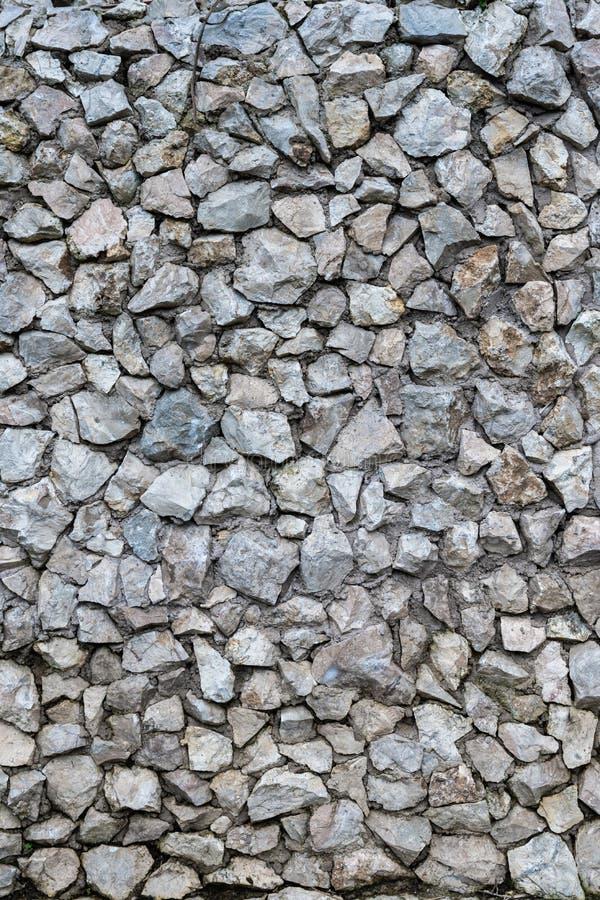 Krossat murverk av grov bakgrund och modellen för textur för stenvägg royaltyfri fotografi