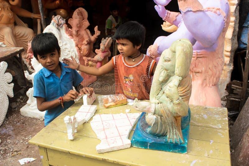 Krottenwijkjonge geitjes India royalty-vrije stock afbeeldingen