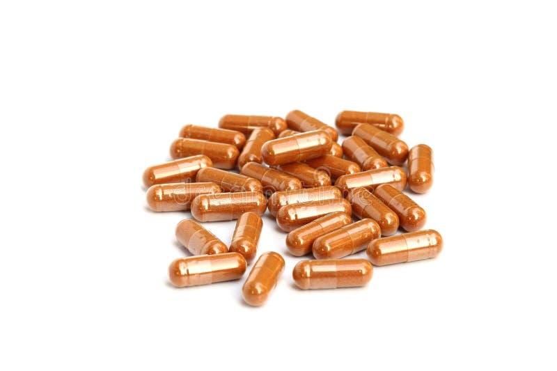 Kruiden drugcapsule royalty-vrije stock fotografie