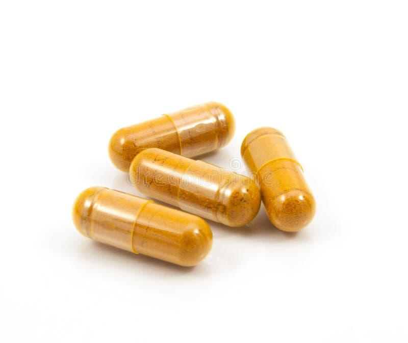 Kruidendrug een alternatieve geneeskunde in capsule stock foto's