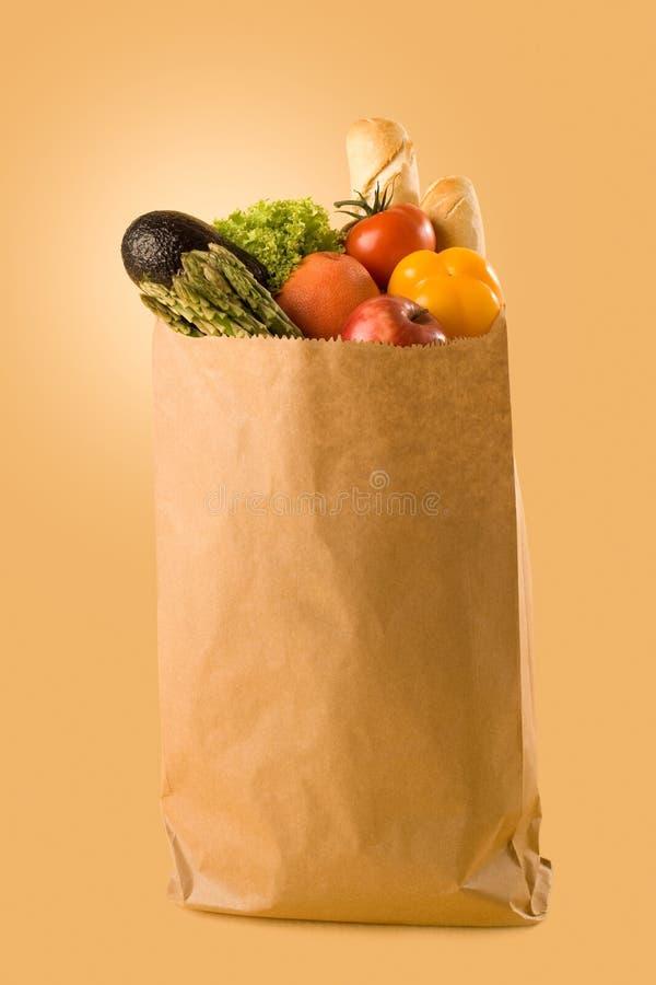 Kruidenierswinkels in een zak stock afbeeldingen