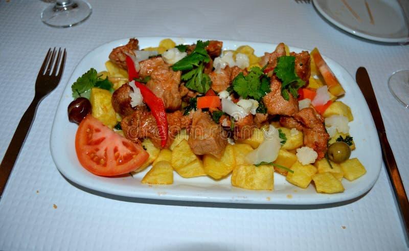 Kruidig Varkensvlees met Aardappels Traditionele Portugese Schotel royalty-vrije stock afbeeldingen