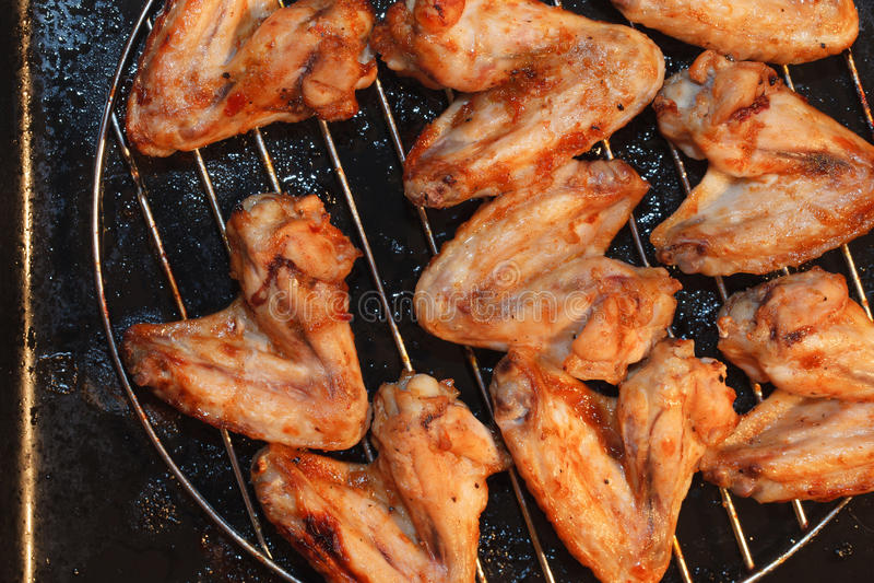 Kruidige kippenvleugels stock afbeelding