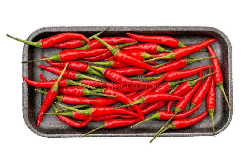 Kruidige roodgloeiende peper op zwart geïsoleerd dienblad stock foto's