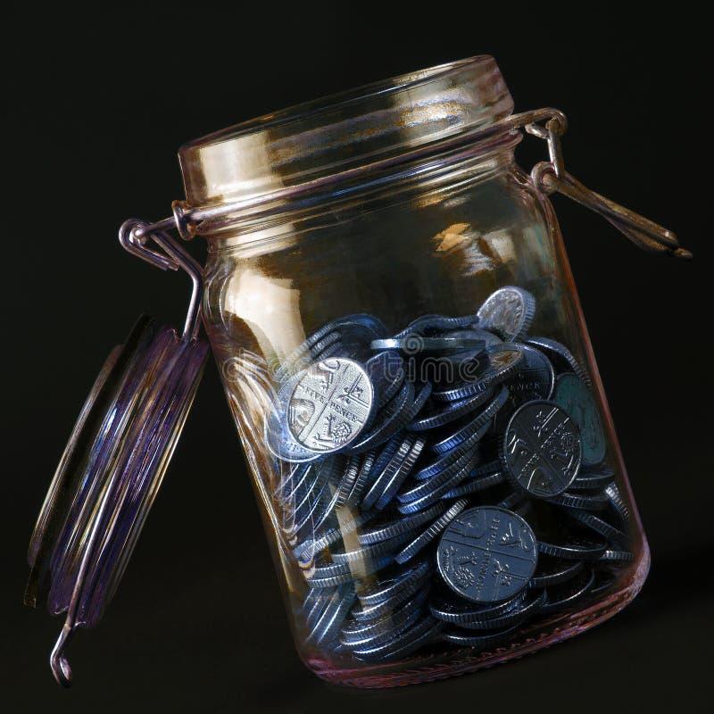 Kruik van muntstukken royalty-vrije stock foto