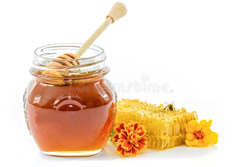 Kruik verse honing stock fotografie