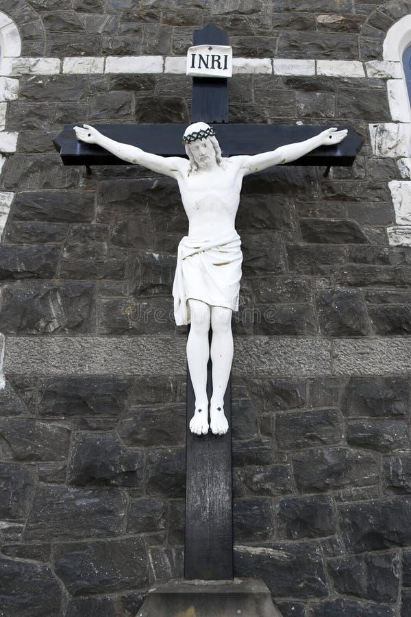 Kruis van de kruisiging op een muur royalty-vrije stock afbeelding