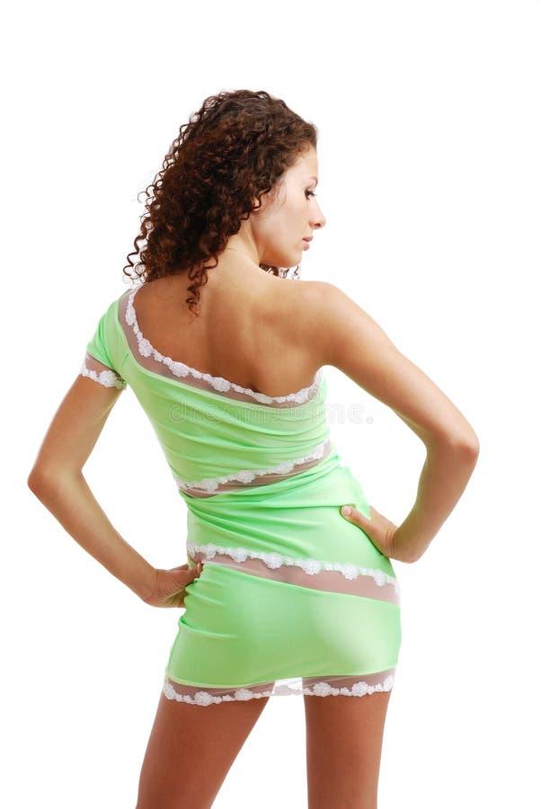 Krullende vrouw in de strakke kleding. stock foto's