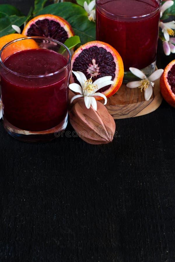 Krwionośny soku pomarańczowego tło zdjęcie royalty free