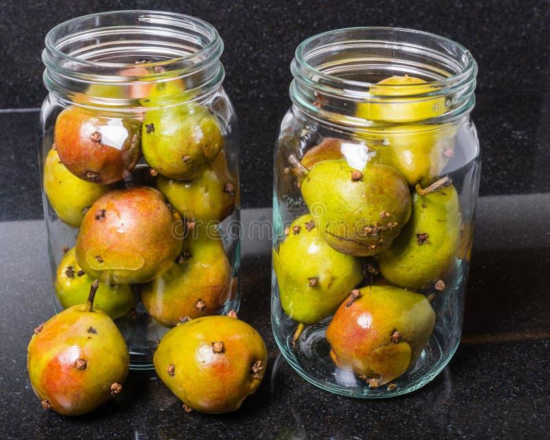 Kryddade seckelpäron som bevaras fotografering för bildbyråer